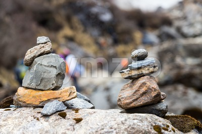 Zen rock arrangement that mimic the Stupa along hiking trail to the mountains of Annapurna, Nepal Stock Photo