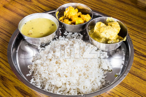 Nepali Thali meal set with chicken curry Stock Photo