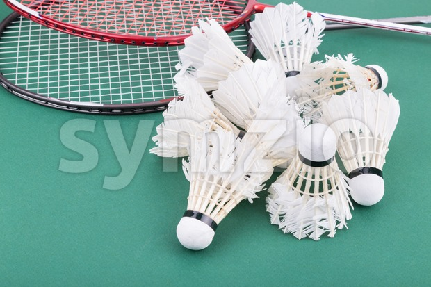Group of worned out badminton shuttlecock with rackets on court Stock Photo
