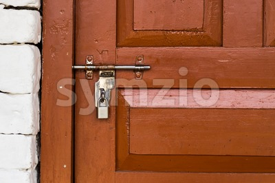 Basic latch and padlock are common way to secure guest rooms at Nepal tea houses Stock Photo