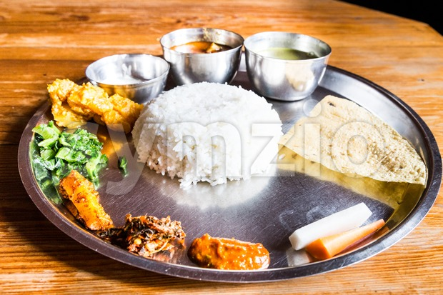 Nepali Thali meal set with chicken curry