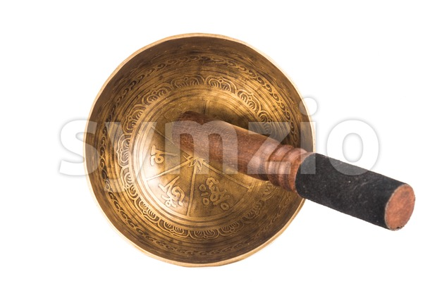 Nepali ancient singing bowl isolated in white Stock Photo