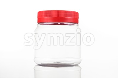 Small translucent plastic PVC jar with red cover isolated in white Stock Photo