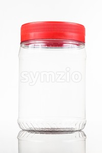 Translucent plastic PVC jar with red cover isolated in white Stock Photo