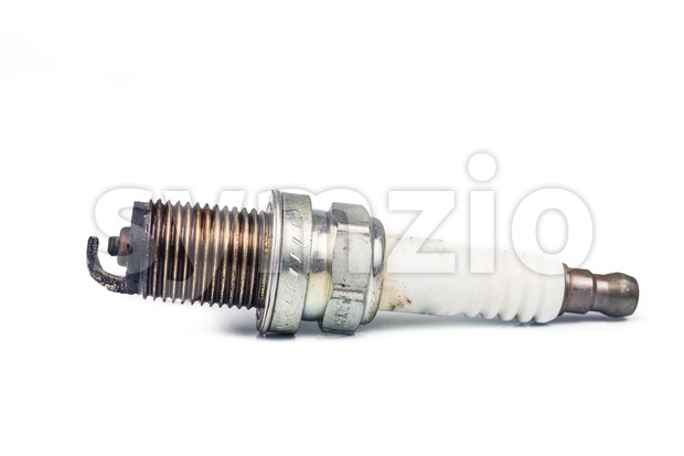 Close up of used spark plugs with focus on the electrode with deposits Stock Photo