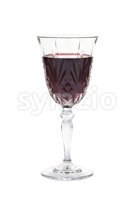 Red wine in luxury crystal glass isolated in white