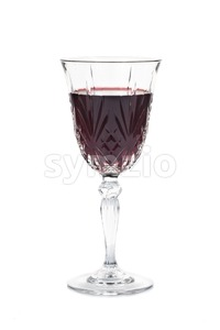 Red wine in luxury crystal glass isolated in white Stock Photo