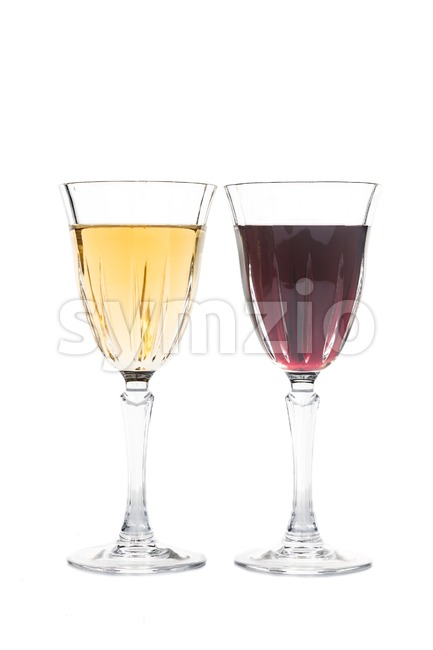 Red and white wine in luxury crystal glass isolated in white