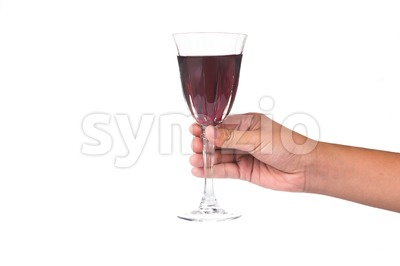 Hand holding red wine in crystal glass and ready to toast and cheers Stock Photo