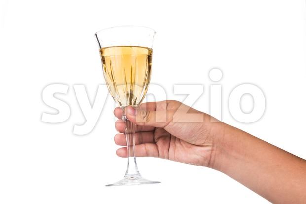 Hand holding white wine in crystal glass and ready to toast and cheers Stock Photo