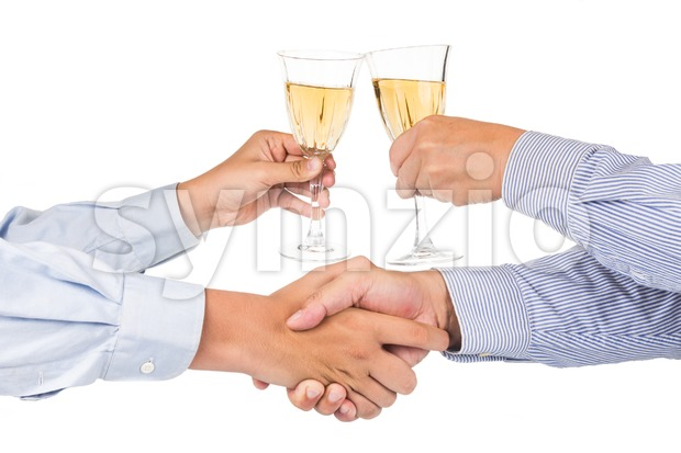 Men shaking hands and toasting white wine in crystal glass