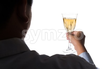 Silhouette image of man holding white wine in crystal glass and ready to toast and cheers Stock Photo