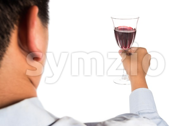 Man holding red wine in crystal glass and ready to toast and cheers