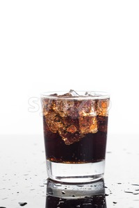 A glass of refreshing cold fizzy cola drinks on vertical format Stock Photo