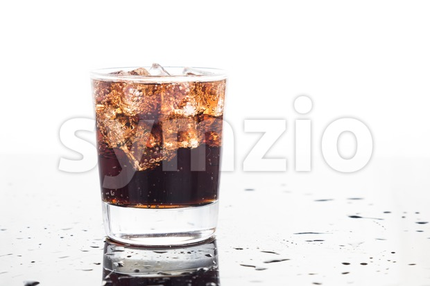 A glass of refreshing cold fizzy cola drinks Stock Photo
