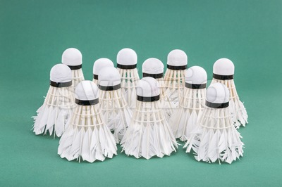 Group of used and worned out badminton shuttlecock on green court Stock Photo
