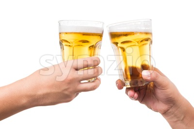 Two hands toasting refreshing cold beer in white background Stock Photo