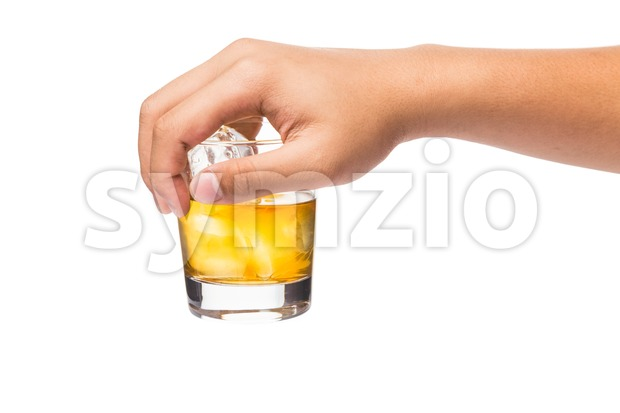 Hand holding a glass of whiskey on the rock from the top Stock Photo