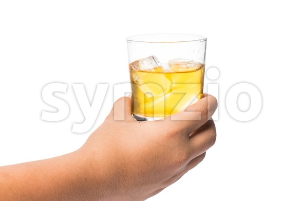 Hand holding a glass of whiskey on the rock ready to toast cheers Stock Photo