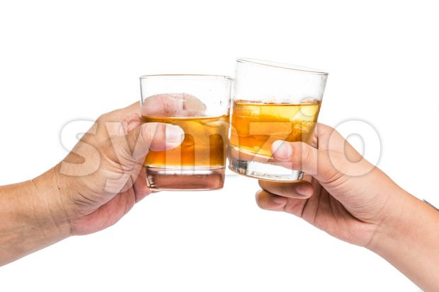 Two hands toasting whiskey on the rock, with background isolated in white Stock Photo