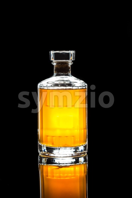 A whiskey bottle in dark background Stock Photo