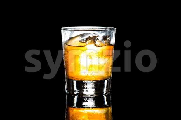 Whiskey on the rock in landscape orientation on a dark background Stock Photo