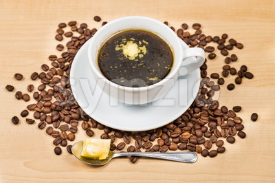 Black coffee with added butter, the new diet that favors high fats low carbo called ketogenic diet Stock Photo
