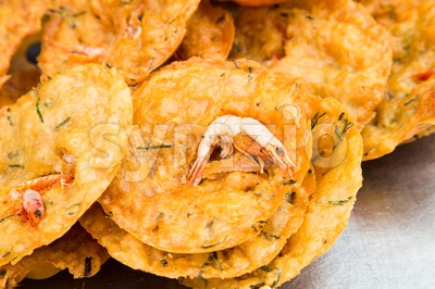 Fried prawn fritters or commonly known as Cucur Udang, a popular snack in South East Asian countries. Stock Photo