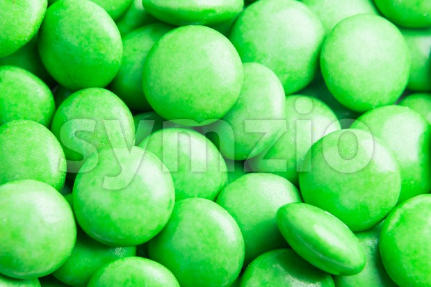 Close up on pile green milk chocolate candies crisp shell Stock Photo