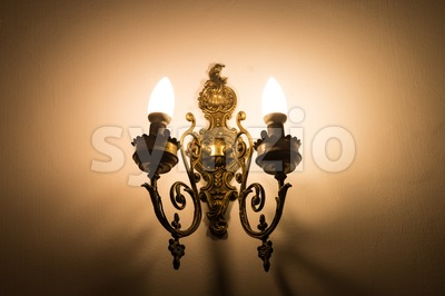 Beautiful old vintage lamp illuminates the interior of a home Stock Photo