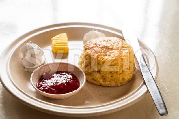 English scones set served on a table next to window