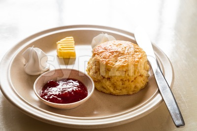 English scones set served on a table next to window Stock Photo
