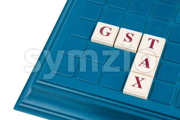 Concept of Goods and Services Tax c. GST TAX alphabet letters on a board game. Stock Photo