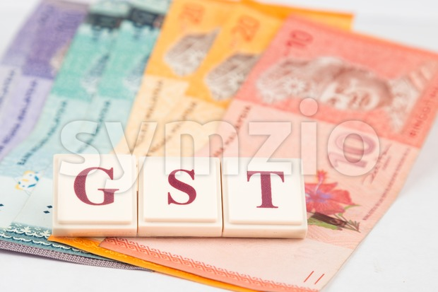 Goods and Services Tax concept. Money on white background with GST alphabet letters and Malaysia Ringgit currency Stock Photo