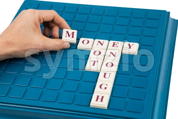 Concept of MONEY NOT ENOUGH on a crossword board game Stock Photo