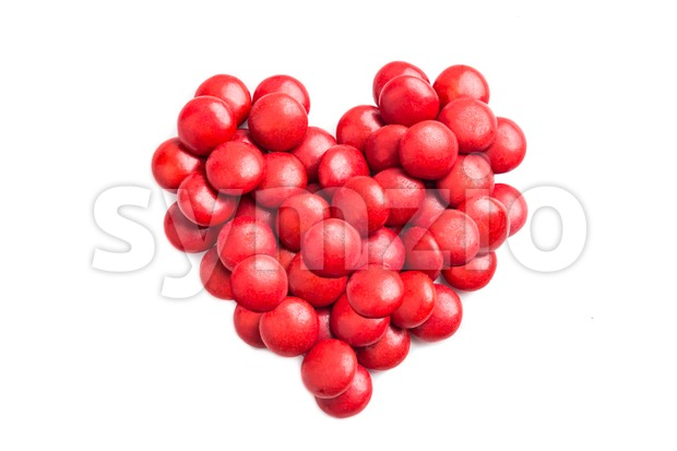 Heart shape with red milk chocolate candies on white background Stock Photo