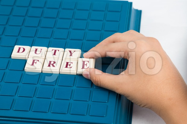 Concept of DUTY FREE text on a cross word board game Stock Photo