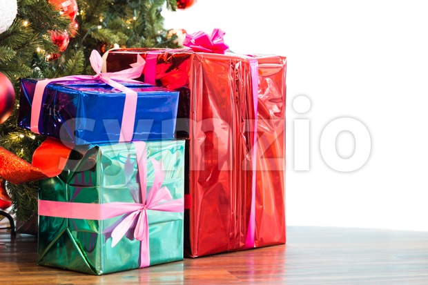 Colorful Christmas gift boxes and presents under the Christmas tree isolated in white