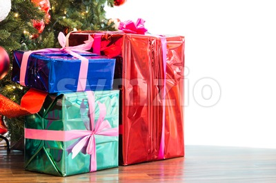 Colorful Christmas gift boxes and presents under the Christmas tree isolated in white Stock Photo