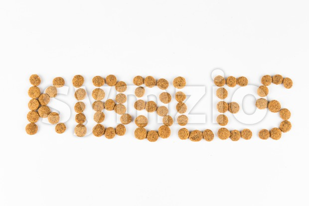The word KIBBLES, formed using actual dog food kibbles Stock Photo