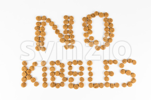 NO to KIBBLES message, formed using actual dog food kibbles Stock Photo