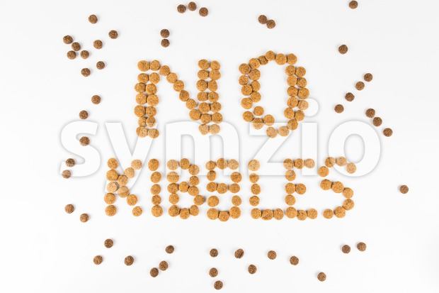 NO to KIBBLES message, formed using actual dog food kibbles
