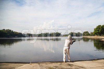 Leisure recreational fishing at a lake on a beautiful morning Stock Photo
