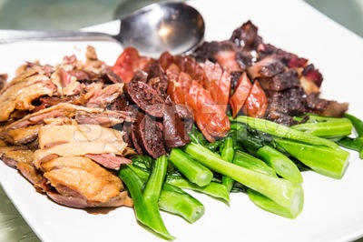 Waxed duck, sausage and preserved meat platter is a traditional delicacy taken by the Chinese during Chinese New Year celebration dinners. Stock Photo