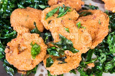 Cruchy Masala Vadai with curry leafs, a popular Southern Indian fried snack Stock Photo