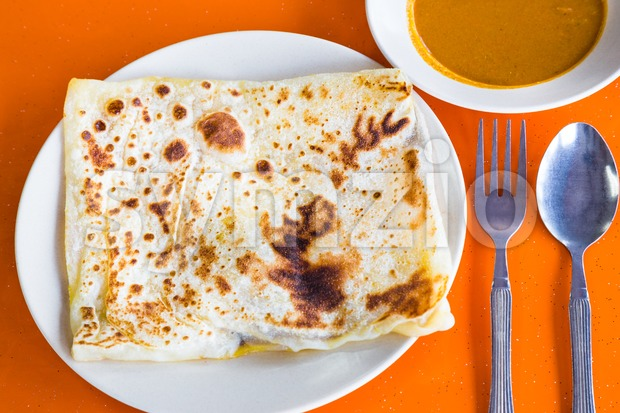 Roti Prata or Roti Canai, a traditional Indian bread served with curry Stock Photo