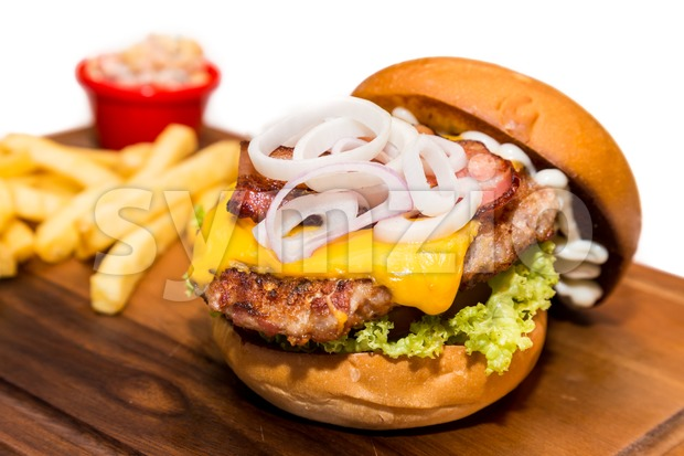 Close up on delicious Pork burger with cheese, vegetable and served with fries Stock Photo