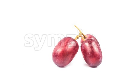 Three pieces of sweet and juicy red crimson grape isolated in white Stock Photo
