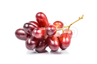 A bunch of sweet and juicy red crimson grape isolated in white Stock Photo