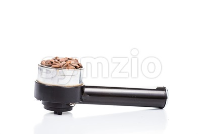 Coffee portafilter filled with coffee beans in white background Stock Photo